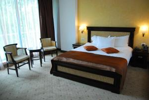 A bed or beds in a room at Hotel Zodiac