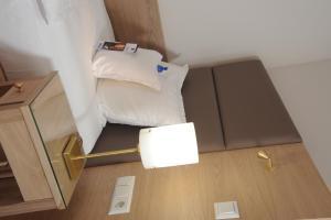 Ein Bett oder Betten in einem Zimmer der Unterkunft Best Western Hotel Der Föhrenhof