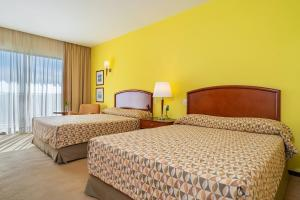 A bed or beds in a room at Bourbon Atibaia Resort