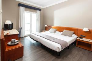 A bed or beds in a room at Astari