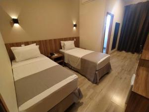 Cama ou camas em um quarto em Minas Platinum Hotel & Convention