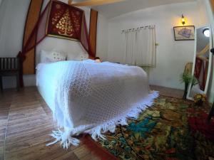 Ein Bett oder Betten in einem Zimmer der Unterkunft Naracha Resort