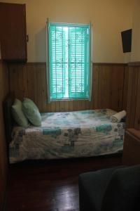 A bed or beds in a room at La Casona Azul