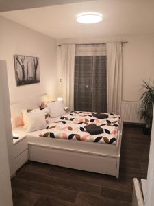 Postel nebo postele na pokoji v ubytování Penzion Cafe Na Svahu