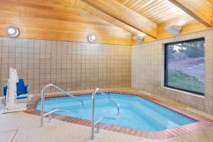 The swimming pool at or near AmericInn by Wyndham Havre