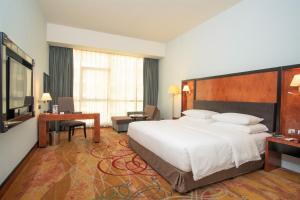 A bed or beds in a room at Millennium Airport Hotel Dubai