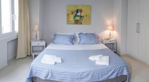 A bed or beds in a room at Heraklion Old Port Apartments