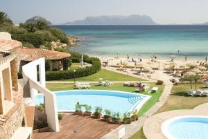 A view of the pool at Hotel Resort & Spa Baia Caddinas or nearby
