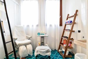 A bathroom at Hotel Resort & Spa Baia Caddinas