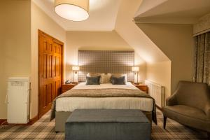 A bed or beds in a room at Murrayshall