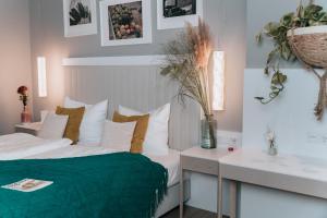 Ein Bett oder Betten in einem Zimmer der Unterkunft The Blasky