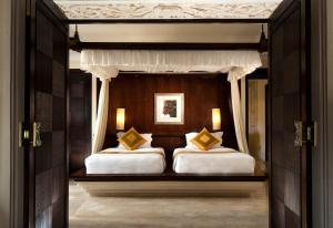 A bed or beds in a room at AYANA Resort and Spa, BALI