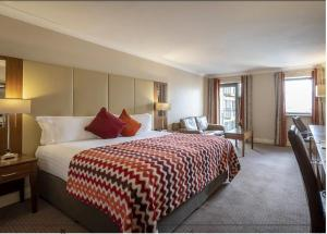 A bed or beds in a room at Royal Marine Hotel