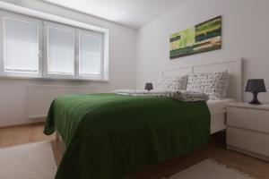 Posteľ alebo postele v izbe v ubytovaní Zoerentals Zlatovska