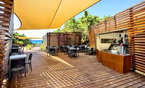 A restaurant or other place to eat at Camping Village Santapomata