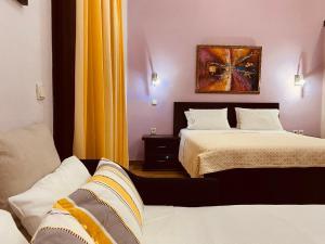 Ένα ή περισσότερα κρεβάτια σε δωμάτιο στο Γαία Καϊμακτσαλάν