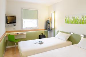 Ein Bett oder Betten in einem Zimmer der Unterkunft Ibis budget Berlin Potsdamer Platz