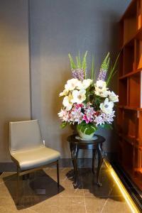 Ein Sitzbereich in der Unterkunft Nostalgia Hotel (SG Clean)