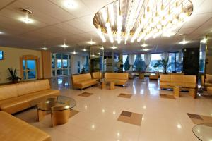 The lobby or reception area at Orbita Hotel