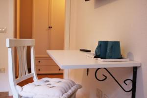 TV o dispositivi per l'intrattenimento presso L'Alloggio-Not just rooms