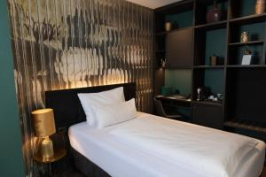 A bed or beds in a room at Aiola Living Graz