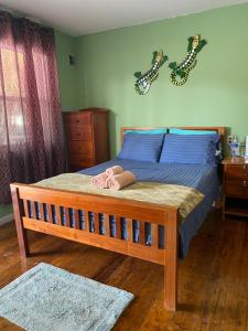 A bed or beds in a room at Go Slow Guesthouse