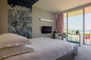 A bed or beds in a room at Radisson Blu Resort & Spa