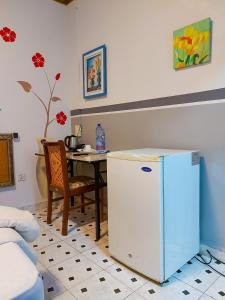 A kitchen or kitchenette at Hotel Relax
