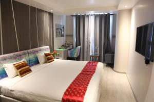 A bed or beds in a room at Kathmandu Guest House by KGH Group