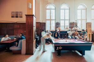 A pool table at Three Little Pigs Hostel - Your Berlin Castle