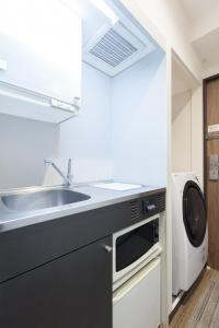 A kitchen or kitchenette at Tokyu Stay Yoga