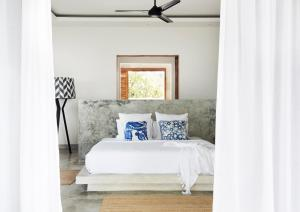 A bed or beds in a room at Villa Selalu