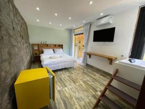 A bed or beds in a room at Pousada R.N.C. Nosso Paraíso