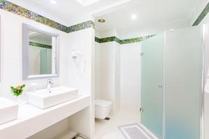 Ett badrum på Atrium Platinum Resort & Spa