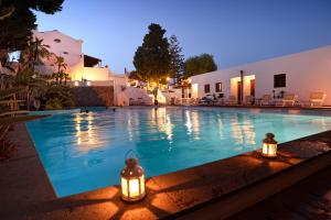 The swimming pool at or near Gattopardo Park Hotel