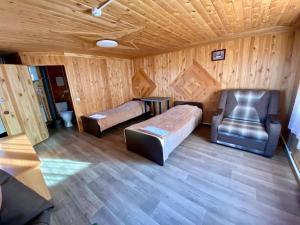 Кровать или кровати в номере Гостевой Дом Отдых на Байкале
