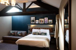 A bed or beds in a room at The Castle, by Innkeeper's Collection