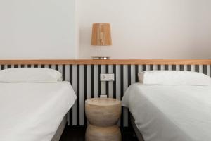 A bed or beds in a room at Hoopoe Villas Lanzarote