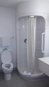 A bathroom at Super 7 Motel