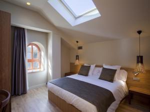 Un ou plusieurs lits dans un hébergement de l'établissement Apartaments Vall de Núria