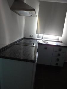 Een keuken of kitchenette bij Hotel Avenida 31