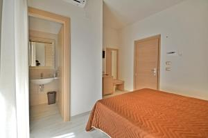 A bed or beds in a room at Hotel Incanto