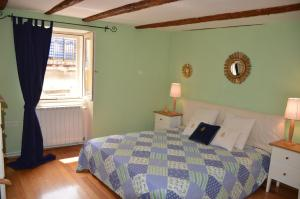 A bed or beds in a room at Apartment Buena Vista Piran