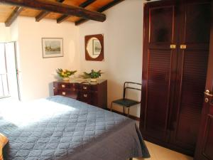 A bed or beds in a room at Hotel Residence Santa Rosa