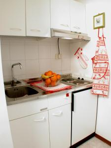 A kitchen or kitchenette at Hotel Residence Santa Rosa