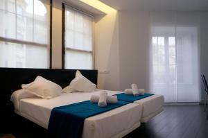 A bed or beds in a room at Loaldia
