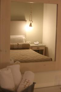 A bed or beds in a room at Hotel Benois