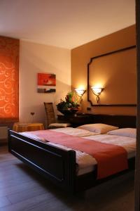 Ein Bett oder Betten in einem Zimmer der Unterkunft Le Pavillon