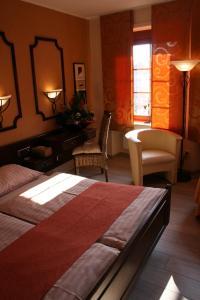 Ein Sitzbereich in der Unterkunft Le Pavillon