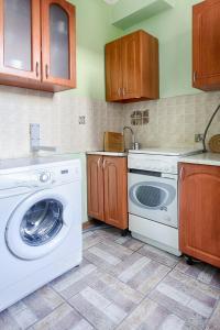 Кухня или мини-кухня в City Inn Апартаменты Белорусская